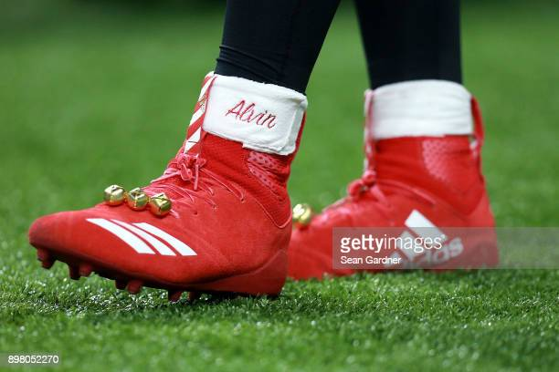 Alvin Kamara of the New Orleans Saints wears holiday themed Adidas cleats for a game against the Atlanta Falcons at the MercedesBenz Superdome on...