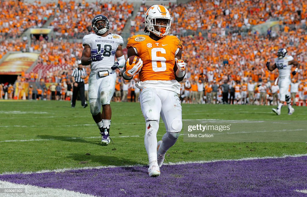 Alvin Kamara #6 of the Tennessee Volunteers scores a touchdown as Anthony Walker #18 of the Northwestern Wildcats reacts during the first half of the Outback Bowl at Raymond James Stadium on January 1, 2016 in Tampa, Florida.