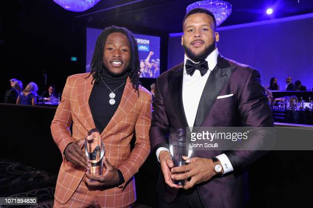 """Alvin Kamara winner of """"Breakout of the Year"""" and Aaron Donald winner of """"Performer of the Year"""" pose with their awards during Sports Illustrated..."""