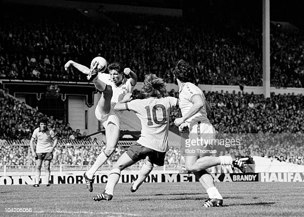 Alvin Martin of West Ham United clears the ball from David Price of Arsenal watched by West Ham's Frank Lampard during the West Ham United v Arsenal...