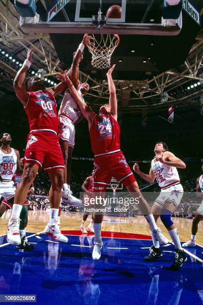 Alvin Robertson of the Eastern Conference AllStars goes for a dunk against the Western Conference AllStars during the 1991 NBA AllStar game on...