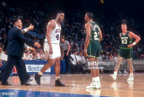 Alvin Robertson of the Milwaukee Bucks argues with Rick Mahorn of the Philadelphia 76ers during Game 3 of the NBA Eastern Division Finals on April 30...