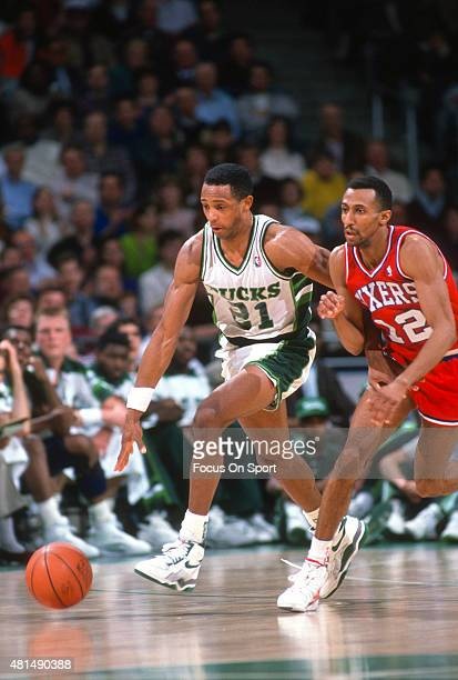 Alvin Robertson of the Milwaukee Bucks dribbles the ball up court past Johnny Dawkins of the Philadelphia 76ers during an NBA basketball game circa...