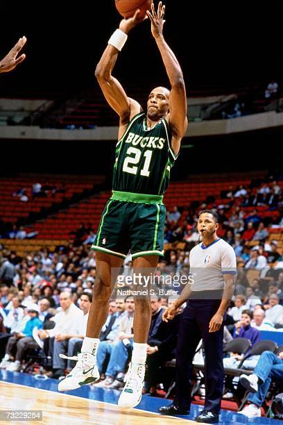 Alvin Robertson of the Milwaukee Bucks shoots against the New Jersey Nets during a game played in 1991 at Continental Airlines Arena in East...