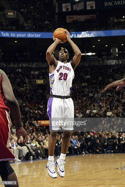 Alvin Williams of the Toronto Raptors shoots against the Cleveland Cavaliers during the game at Air Canada Centre on January 7 2004 in Toronto Canada...