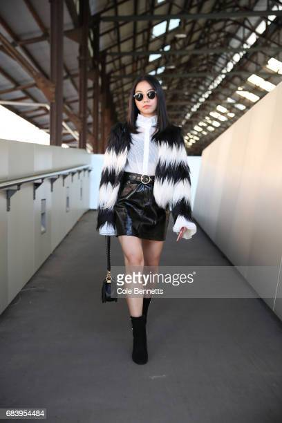 Alvina Tan wearing a Front Row jacket Glasson skirt and Chanel bag during MercedesBenz Fashion Week Resort 18 Collections at Carriageworks on May 17...