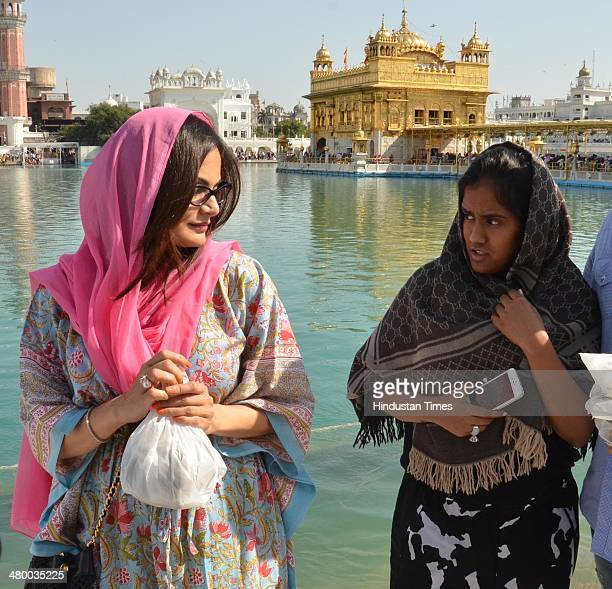 Alvira Khan and and Arpita Khan sisters of Bollywood actor Salman Khan paying obeisance at Golden Temple on March 22 2014 in Amritsar India