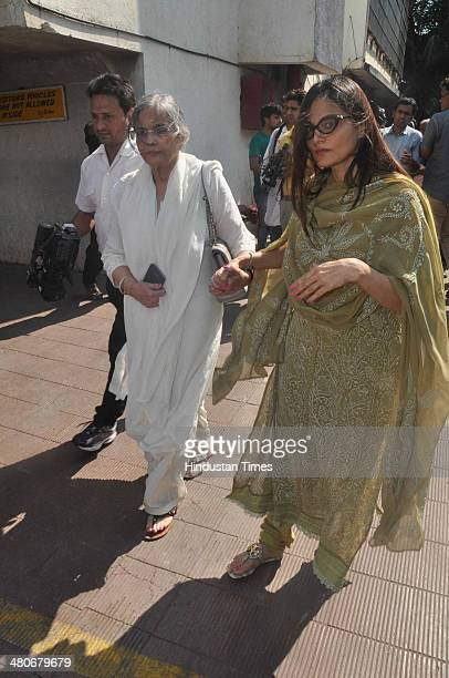 Alvira Khan her mother Salma during funeral of veteran actress Nanda at Oshiwara on March 25 2014 in Mumbai India