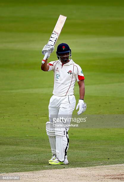 Alviro Petersen of Lancashire celebrates his century and a half duriung day two of the Specsavers County Championship division one match between...