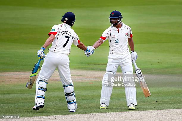 Alviro Petersen of Lancashire celebrates his century and a half with team mate Liam Livingstone during day two of the Specsavers County Championship...
