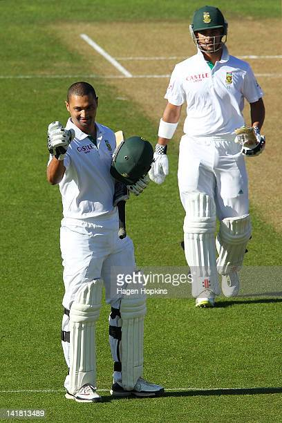 Alviro Petersen of South Africa celebrates his century while teammate JP Duminy looks on during day three of the Third Test match between New Zealand...