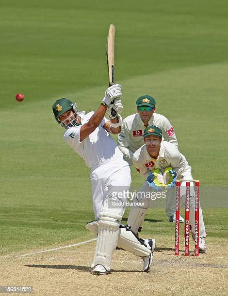 Alviro Petersen of South Africa hits a boundary as Michael Clarke and Matthew Wade of Australia look on during day two of the Second Test match...