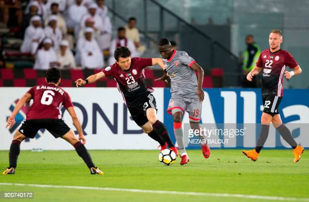 AlWahda's Rim Chang Woo fights for the ball against alDuhail's Almoez Ali during their AFC Champions League round 2 group B stage football match at...