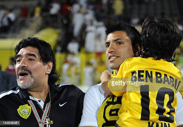 AlWasl club's Argentinian head coach Diego Maradona stands with his son in law Manchester City's Sergio Aguero and his grandson Benjamin at the end...