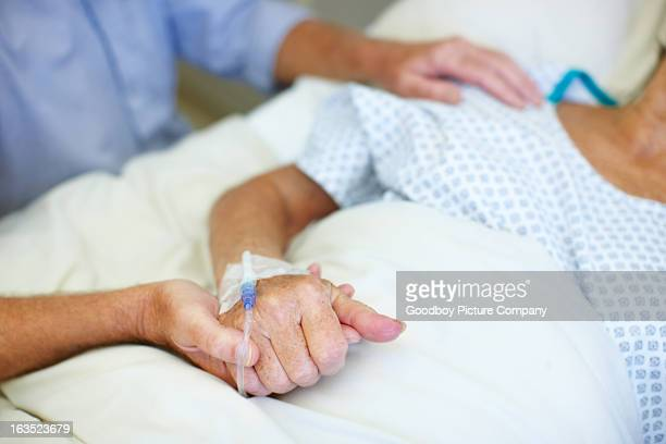 always at her bedside - iv drip stock pictures, royalty-free photos & images