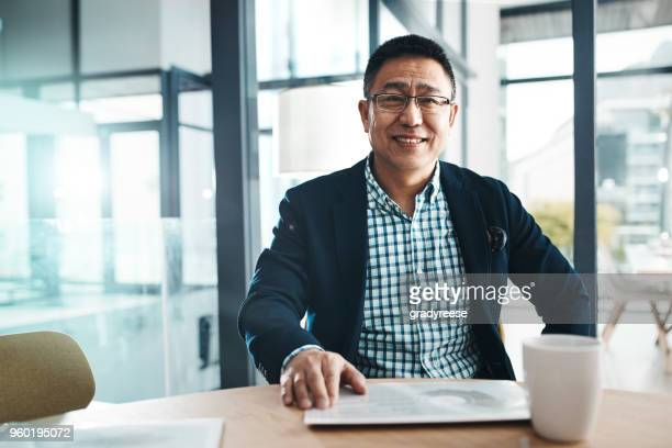 i always bring success to my name - man in office stock photos and pictures