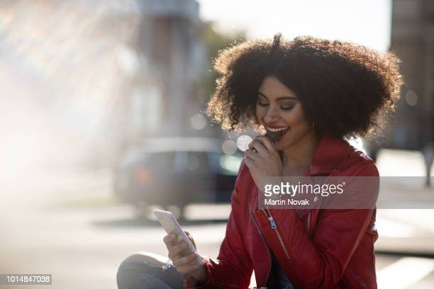 Always connected - teen girl on phone in street