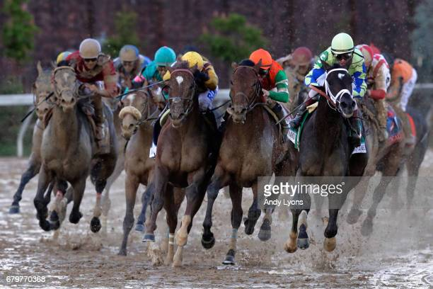 Always Dreaming ridden by jockey John Velazquez leads the field into the fourth turn during the 143rd running of the Kentucky Derby at Churchill...