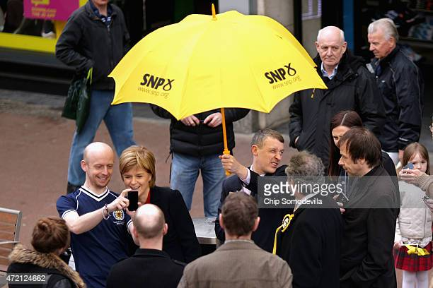 Always happy to pose for a 'selfie' First Minister and leader of the Scottish National Party Nicola Sturgeon campaigns for SNP candidate Roger Mullin...