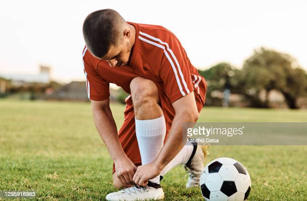 always prepare yourself for a free-kick - football player stock pictures, royalty-free photos & images