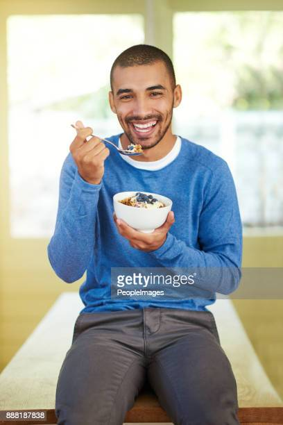 i always start my day with a healthy breakfast - man eating woman out stock photos and pictures