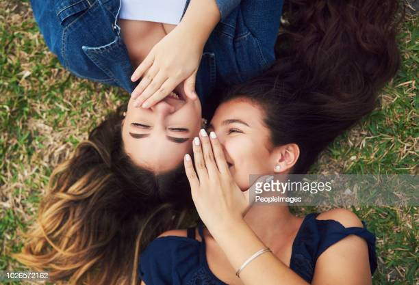 i always tell her all my secrets - whispering stock pictures, royalty-free photos & images