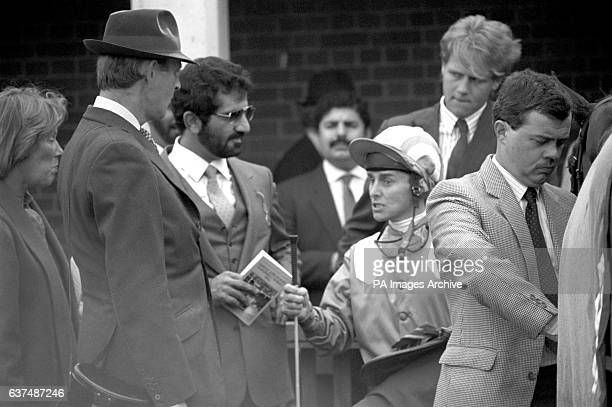 'Alwuhush' trainer John Dunlop and owner Hamdan Al Mektaum talk with jockey Willie Carson after the horse had finished 3rd in the Darley Stakes at...