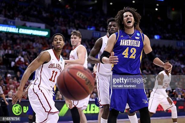 Aly Ahmed of the Cal State Bakersfield Roadrunners reacts alongside Isaiah Cousins of the Oklahoma Sooners in the first half in the first round of...