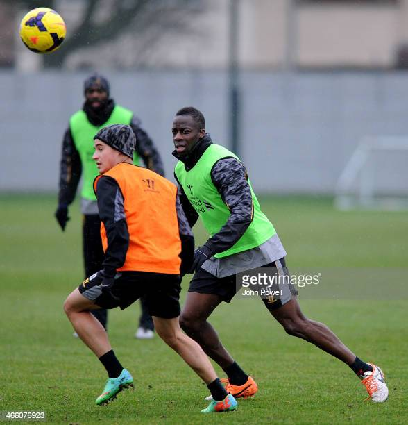 Aly Cissokho and Philippe Coutinho of Liverpool in action during a training session at Melwood Training Ground on January 31 2014 in Liverpool England