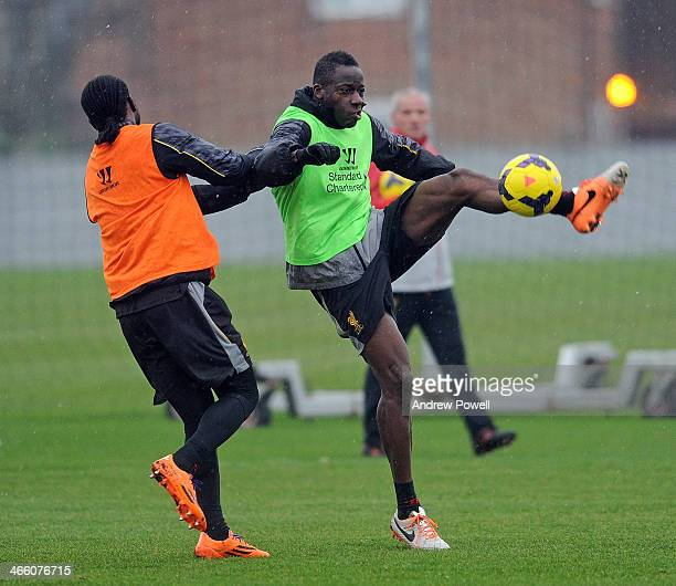 Aly Cissokho and Victor Moses of Liverpool in action during a training session at Melwood Training Ground on January 31 2014 in Liverpool England