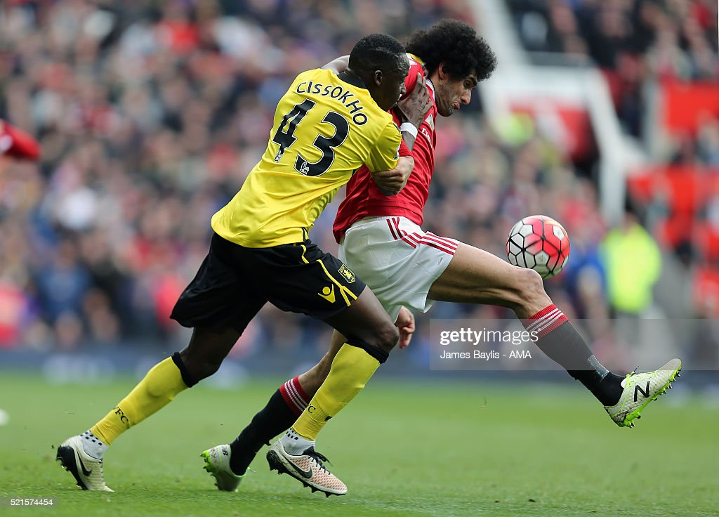 Aly Cissokho of Aston Villa and Marouane Fellaini of Manchester United during the Barclays Premier League match between Manchester United and Aston Villa at Old Trafford on April 16, 2016 in Manchester, England