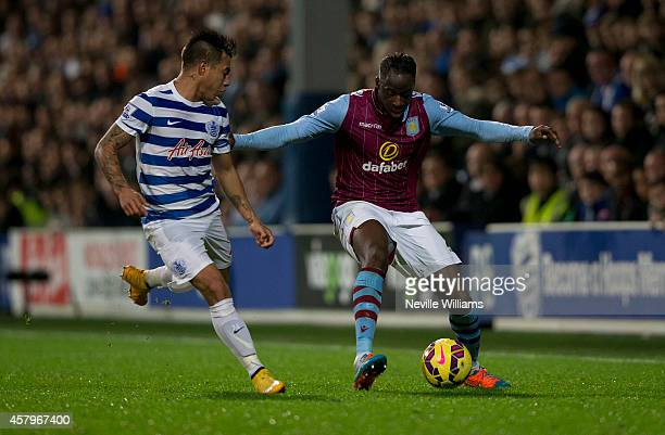 Aly Cissokho of Aston Villa is challenged by Eduardo Vargas of Queens Park Rangers during the Barclays Premier League match between Queens Park...