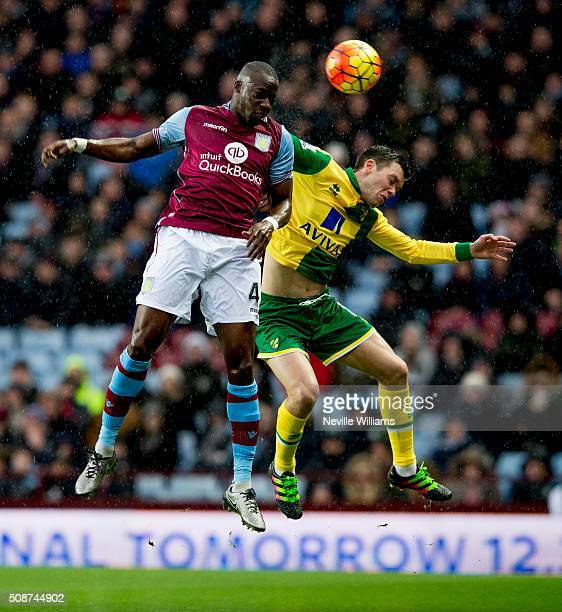Aly Cissokho of Aston Villa is challenged by Jonny Howson of Norwich City during the Barclays Premier League match between Aston Villa and Norwich...