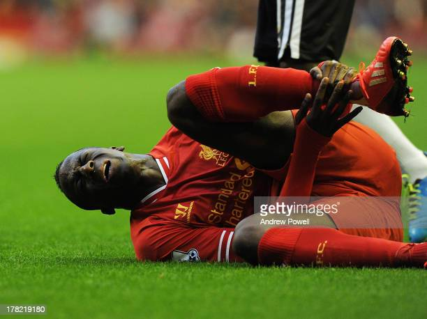 Aly Cissokho of Liverpool is injured in play during the Capital One Cup second round match between Liverpool and Notts County at Anfield on August...