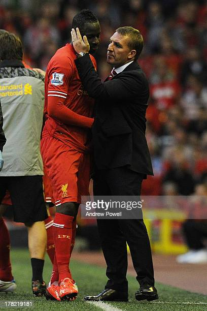 Aly Cissokho of Liverpool is spoken to by manager Brendan Rodgers as he is substituted off the pitch after suffering an injury during the Capital One...