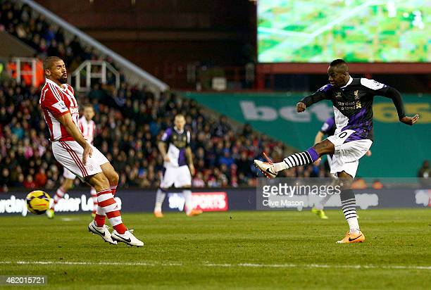 Aly Cissokho of Liverpool shoots as his shot deflects in off Ryan Shawcross of Stoke City for an own goal for their first goal during the Barclays...