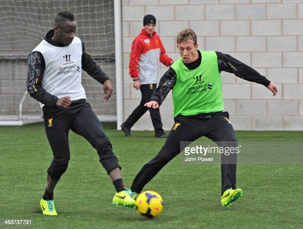 Aly Cissokho of Liverpool with Lucas Leiva of Liverpool at Melwood Training Ground on December 5, 2013 in Liverpool, England.