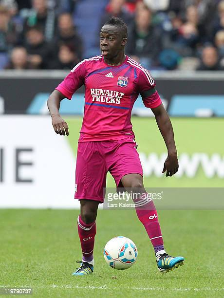 Aly Cissokho of Lyon runs with the ball during the pre season friendly match between Hannover 96 and Olympique Lyon at the AWD Arena on July 24, 2011...