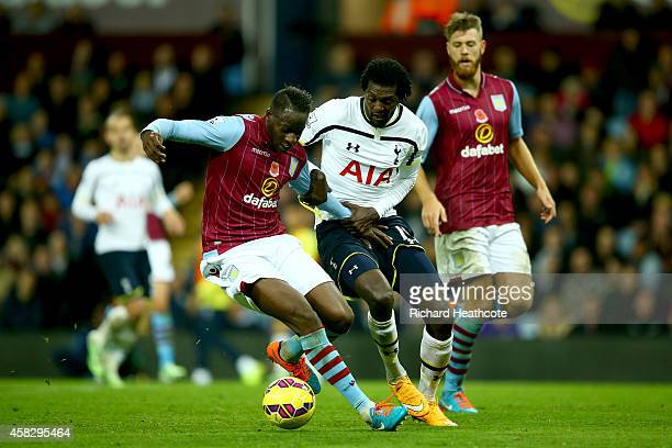 Aly Cissokho of Villa holds off Emmanuel Adebayor of Spurs during the Barclays Premier League match between Aston Villa and Tottenham Hotspur at...