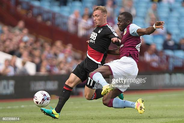 Aly Cissokho of Villa in action with Ben Osborn of Notts Forest during the Sky Bet Championship match between Aston Villa and Nottingham Forest at...