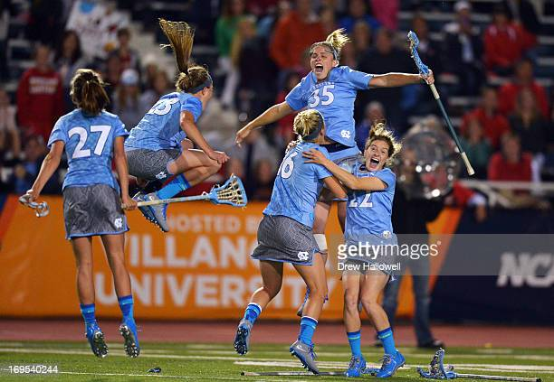 Aly Messinger Taylor George Sloane Serpe Brittney Coppa and Emily Garrity of University of the North Carolina Tar Heels celebrate their 1312 overtime...