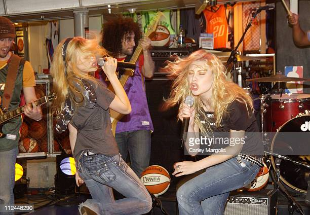 Aly Michalka and AJ Michalka during Aly and AJ Perform in Celebration of the WNBA's 10th Anniversary at NBA Store in New York City New York United...