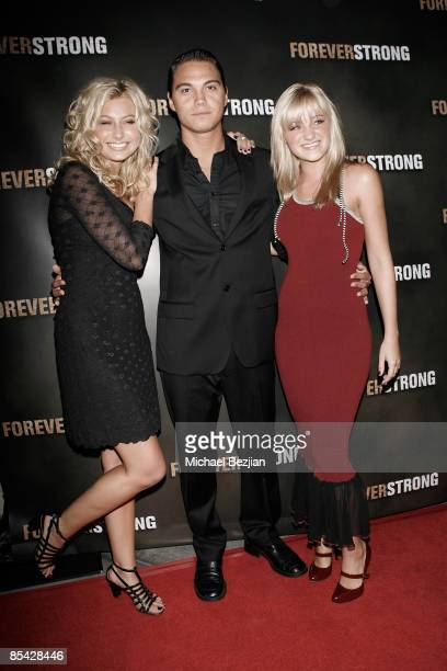 Aly Michalka Kepa Kruse and AJ Michalka arrives at the Los Angeles Red Carpet Screening of Forever Strong at the Arclight Hollywood on September 24...