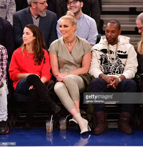 Aly Raisman Lindsey Vonn and Cam'ron attend the Houston Rockets Vs New York Knicks game at Madison Square Garden on November 1 2017 in New York City