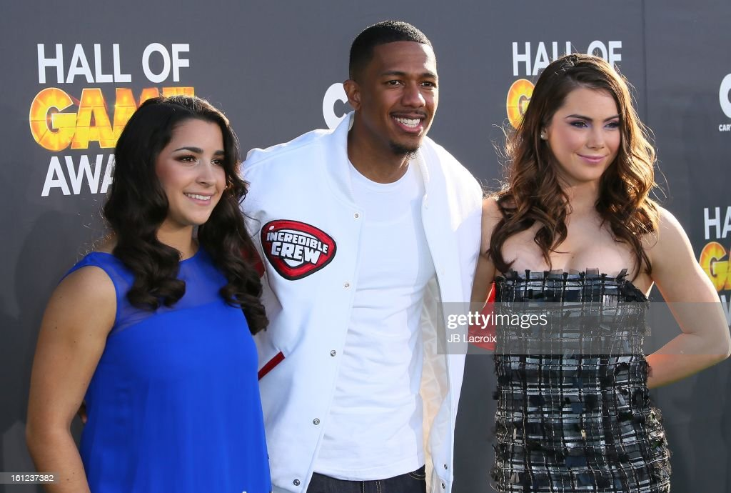 Aly Raisman, Nick Cannon and McKayla Maroney attend the Third Annual Hall of Game Awards hosted by Cartoon Network at Barker Hangar on February 9, 2013 in Santa Monica, California.