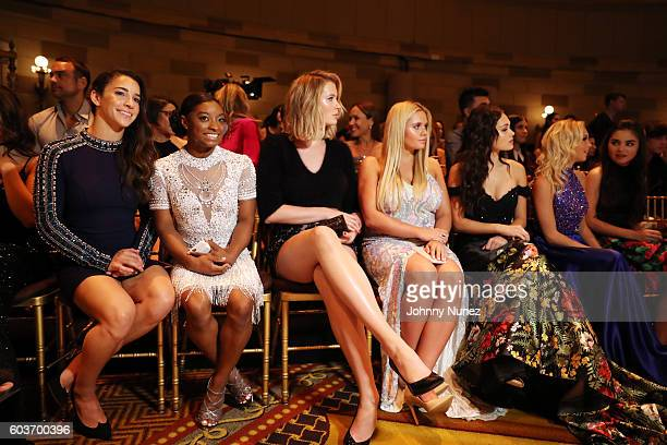 Aly Raisman Simone Biles Ireland Baldwin Allie Simpson Kelli Berglund Jordyn Jones and Landry Bender attend the Sherri Hill presentation at Gotham...