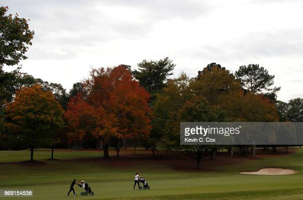 Alyaa Abdulghany of the USC Trojans and Albane Valenzuela of the Stanford Cardinal walk up the 16th hole during day three of the 2017 East Lake Cup...