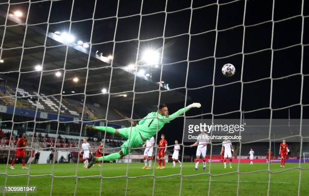 Alyaksandr Hutar of Belarus fails to save Belgium's third goal scored by Leandro Trossard during the FIFA World Cup 2022 Qatar qualifying match...