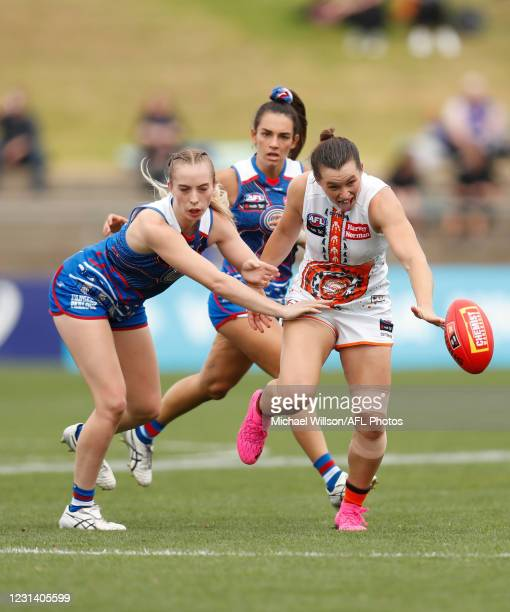 Alyce Parker of the Giants and Sarah Hartwig of the Bulldogs compete for the ball during the 2021 AFLW Round 05 match between the Western Bulldogs...