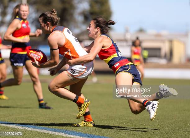 Alyce Parker of the Giants is tackled by Angela Foley of the Crows during the 2020 AFLW Round 06 match between the Adelaide Crows and the GWS Giants...